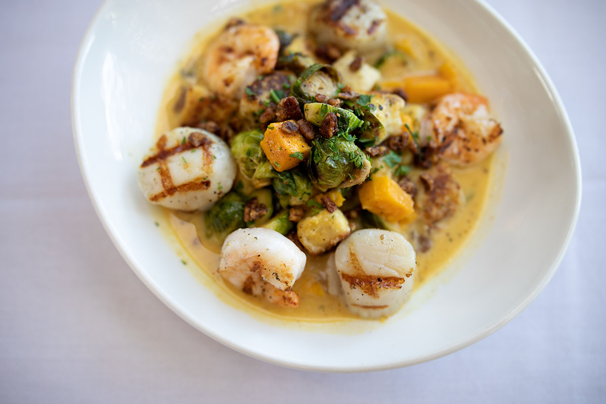 Visit our Chattanooga restaurant and try our seasonal dishes before they're gone! This Grilled Shrimp & Scallops Gnocchi is a must not miss seasonal menu item!